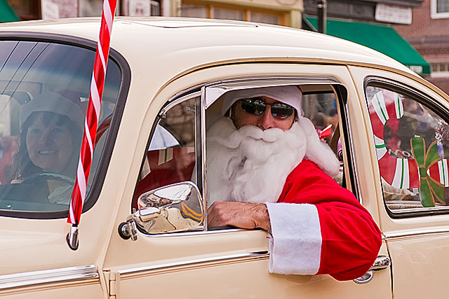 The heck with a sleigh, Santa arrives in a classic VW Beetle.
