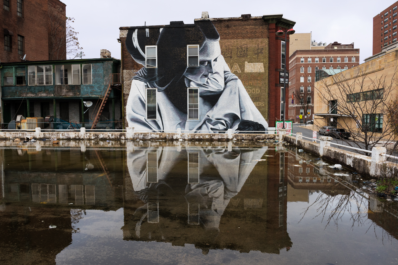 Weak composition - the mural and its reflection compete for attention with the other elements in the scene